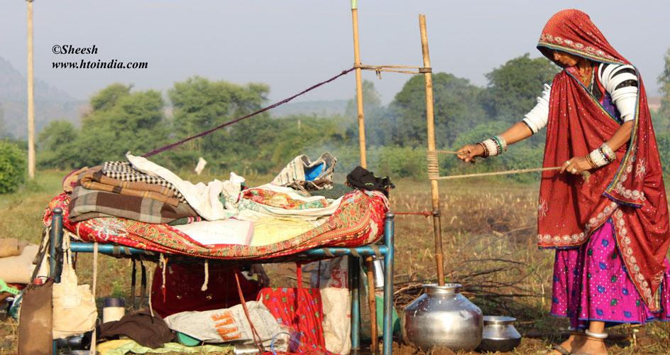 Rabari Lady Making Butter during a local visit during Gujarat Tribal Tour