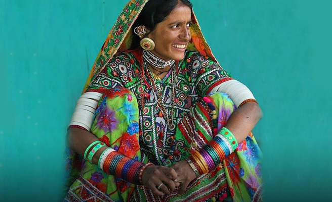 Rabari Lady Dresses and bangles in upper arms.