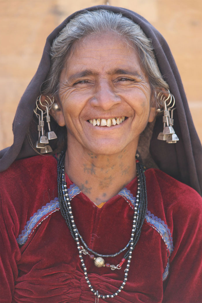A Kutchhi Rabari Tribe lady with tattoos on her neck.