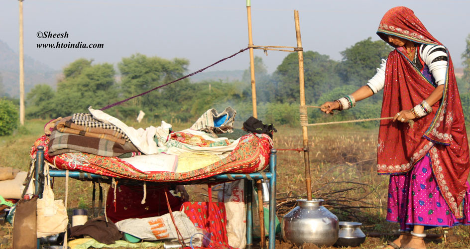 A Rabari woman making butter in her camp in Gujarat