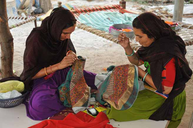 Ahir ladies embroidering at their home